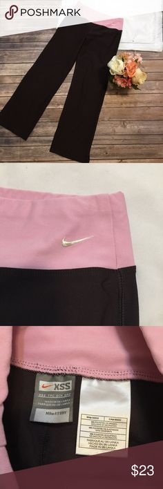 "Nike | Brown & Pink Flare Leggings Size XSS Great used condition! Any signs of wear or imperfections are shown in images. Approximate measurements- waist: 23"" un stretched   Outseam: 34""    Inseam: 26.5""    Front rise: 9"" Nike Pants"