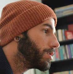 Stretched earlobe and a nostril ring