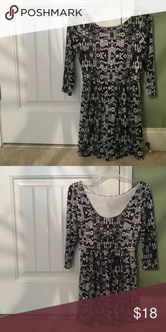 Adorable black & white geometric dress Barely worn!! This dress features a cute pattern along with 3/4 length sleeves 💕 the second picture is the back of dress which features a lower cut than the back (does not make bra visible) Lily Rose Dresses Long Sleeve