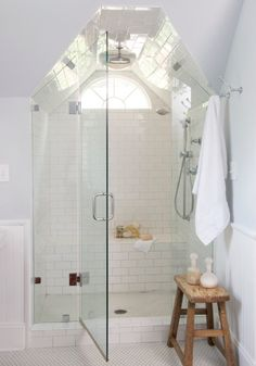 Subway tile shower with hex tiles on the floor - all gray grout.  Also love the wood color of the stool against the white