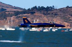 INCREDIBLE BLUE ANGELS LOW PASS FLY BY IN SAN FRANCISCO HARBOR - NOTE WIND CONE ON WATER - LOOK CLOSELY AT THE AIR DISTORTION NEAR THE TAIL!