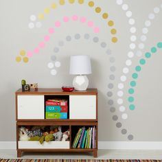 Colorful polka dot wall decals creating a design