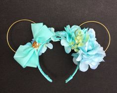 Gold wire ears with varying shades of pale, aqua blue to represent Princess Jasmine. There is also an aqua blue bow with a gold sequin accent. Disney Mickey Ears, Mickey Mouse Ears, Blue Bow, Aqua Blue, Princess Jasmine, Disney Princess, Disney Headbands, Bows, Gold Wire