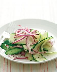 Raw zucchini, sliced into ribbons with a peeler, is mild-tasting; a short soak in vinegar and oil mellows and softens the onion but leaves enough bite to keep it interesting.