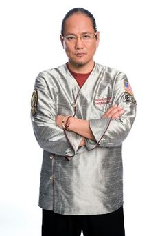 I like the fact that they used the same colors of his original outfit on Iron Chef in japan