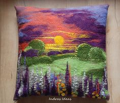Pretty, in a collection of vibrant pillows on a bold, simple lined couch. dlefelted pillow cover by Indra (Indras Ideas), stitching over the felting.love the intense sky with flowers echoing. Felt Cushion, Felt Pillow, Wet Felting, Needle Felting, Felt Pictures, Wool Art, Art Textile, Landscape Quilts, Quilting