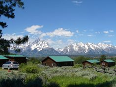 National Park Lodges: Five Hidden Gems The Grand Teton Mountain range juts up outside the cabins at Triangle X Ranch in Grand Teton National Park, Wyo. National Park Lodges, National Park Tours, Grand Teton National Park, Yellowstone National Park, National Parks, Teton Mountains, Yellowstone Vacation, Honeymoon Spots, Hotel Motel