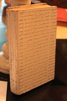 """Spray paint old book """"heirloom white"""" then stamp with script"""