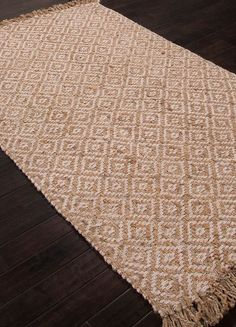 A dramatic diamond pattern is created on this all-natural 100% Jute Tobago Island Area rug with decorative knotted fringed edges completing the intricate coastal look.