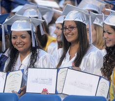 Cousins Daisy Jimenez, Kyra Jimenez and Natalie Jimenez show their diplomas during the Chambersburg Area Senior High School graduation on Friday, June 8, 2012. (Public Opinion/Ryan Blackwell)