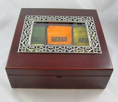 Wooden Tea Box with Crystal & Pewter Frame Window includes 45 TAZO Tea Bags in 9 flavors. Hinged, Cherry Finished Wooden S... $64.95