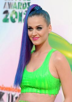 Katy Perry.....her songs never fail to make me happy, plus i LOVE her line of False Eyelashes