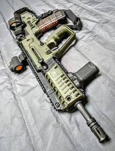 IWI Tavor X95, Olive Drab Green, outfitted with Trijicon MRO sight.