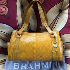 Brahmin large Gold purse 👜 Gold tone leather. Spacious with side pockets. Zipper closure. Excellent condition.  Dust cover included. Straps will fit on shoulder like a tote. Brahmin Bags Shoulder Bags