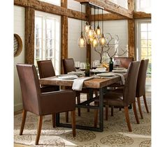 I like the lights, not so much the leather chairs.  Paxton Glass 8-Light Pendant-Pottery Barn