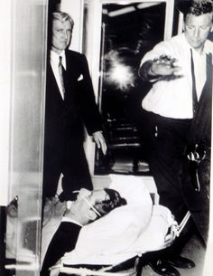 *#16 - RFK's Assassination:  One of the last photos of Kennedy, as he is being transported to the hospital. Kennedy died at 1:44 PDT, on June 6th, nearly 26 hours after the shooting. He was only 41 years-old + was survived by his wife + 11 children. The last child, Rory was born six months after the assassination.