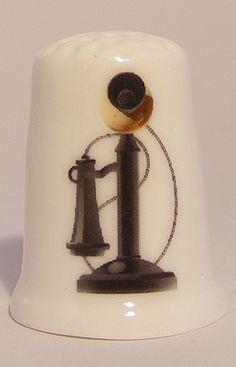 Antique phone porcelain thimble These are for sale by https://www.speelgoedenverzamelshop.nl/vingerhoedjes/algemeen/antiek_telefoon_bedrukt_porselein_vingerhoedje_7918.html