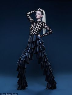 That's quite the look: Inside the publication, she models a sheer lattice bodysuit by Balm...