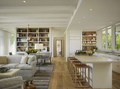 I love the open design of this place. The kitchen is white and bright. There are lots of compartments. The dining and living room seam seamlessly and still have windows.