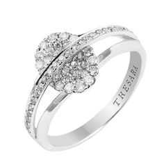This diamond ring is set with 0.45 Carat T.W. micro pavé diamonds. The stones are set into the oval center with a row of diamonds sweeping over the center. It also features a high-polished band behind it.