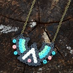 Check out how easy and fun it is to make a fashionable tribal-inspired perler bead necklace! Perfect for summer!