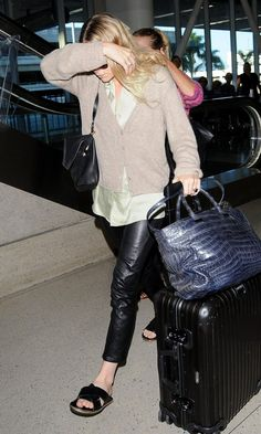 Olsens Anonymous Blog Ashley Olsen Comfy Chic Airport Look Satin Button Down Leather Pants The Row Bag photo Olsens-Anonymous-Blog-Ashley-Ol...