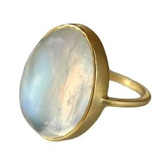 This absolutely belongs on my wife's finger.    Gold Moonstone Ring by Conroy