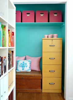 A colorful filing cabinet and boxes look charming next to a quaint bench where you can consult paperwork, flip through a book, or stow extra supplies under the seat.