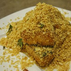 """Love this sweet and savoury Singaporean favourite! Butter Oat Fried Tofu (popular to do with prawns, which is delicious!) - made with butter, cereal flakes, garlic, crispy curry leaves, chilli padi, sugar, salt etc. The cereal flakes, sometimes called """"oats"""" are not the instant oatmeal porridge. It's the instant cereal flakes that are thin, crispy, sweet and flaky. #FMFinSingapore #Singapore Cereal Flakes, Oatmeal Porridge, Curry Leaves, Prawn, Tofu, Singapore, Fries, Garlic, Salt"""