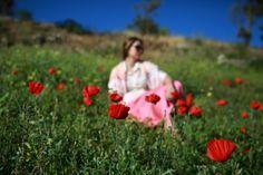 In poppies! Spring in Santorini! Photo by Maryna Gruzdyeva.