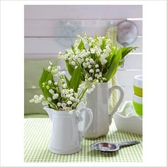love the look of flowers in water pitchers and the white and green gives an overall clean and crisp look.