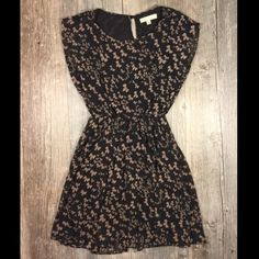 Black and Tan bow print cinch waist dress Black and Tan bow print cinch waist dress. 33 inches long. Sheer flowy dress with attached slip. Polyester. Tag read XS. Lush Dresses