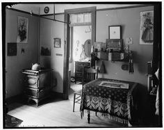 1910 NY tenement apartment. Notice the flue cover on the wall. The stove is now gas, but once was coal and had a stovepipe.