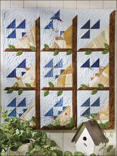 """Free Classic Quilting Patterns - Flocking Together...A scrap-pieced nest, complete with prairie-point babies, enlivens the traditional Birds in the Air block pattern in this fun wall quilt. This e-pattern was originally published in Start With Scraps. Size: 34 1/2"""" x 37"""". Block Size: 10"""" x 10"""".  Skill Level: Intermediate Designed by Carol E. Loessel"""