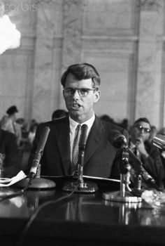 Attorney General Robert Kennedy Speaking into Mic Original caption: Attorney general Robert F. Kennedy testified before the Senate Commerce Committee today on the Administration's civil rights bill. He said he opposed any changes in the bill that would water down the proposed ban on discrimination in public accommodations. Stock Photo ID: U1385682 Date Photographed: July 1, 1963