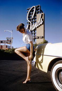 Vintage Las Vegas — Las Vegas, 1955. A model poses next to a '54 Buick...