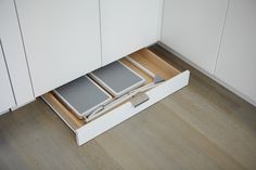 This is another storage trick I love.  Utilize the wasted space behind a cabinet toe kick by building in drawers.