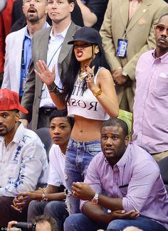 Nail-biter! Singer Rihanna wore a cropped-top, jeans and a black baseball cap to the NBA playoffs between The Los Angeles Clippers and the Oklahoma City Thunder Sunday night at the Staples Center in LA alongside her friend Melissa Forde
