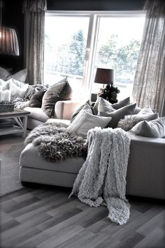 Cosy grey shaded living room with throws and cushions