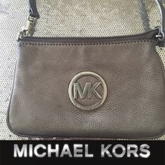 MK Leather Wristlet Good condition small makeup stain in the inside (see photo ) MICHAEL Michael Kors Bags Clutches & Wristlets