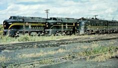A line of Pennsylvania Railroad Streamlined EMD and Baldwin Diesel locomotives are ready for service at Erie, Pennsylvania. Circa October, 1958. (Photo by William Volkmer)
