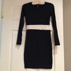 Black bodycon dress with white stripe Simple and cute black mini dress with stripe. Size small. Brand new in original packaging. Dresses Mini