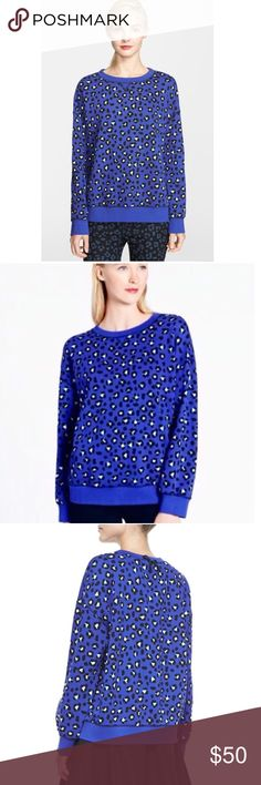 Kate Spade Cyber Cheetah Tokyo Sweatshirt This is a Kate Spade Cyber Cheetah Tokyo Sweatshirt. Great condition. The color is like a bluish purple.  Size large Armpit to armpit- 27in Length- 25in 100% cotton kate spade Tops Sweatshirts & Hoodies