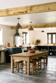 A gorgeous mix of deVOL Shaker cupboards, a big antique dining table and chairs and copper accessories