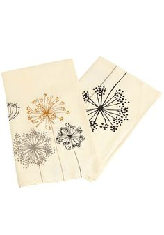 parachute and seed tea towels || {pillowcases // decor vertical on top of bed}