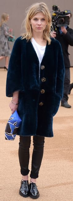 French actress Clémence Poésy on the red carpet at the Burberry show wearing a navy shearling coat and a book cover print pouch