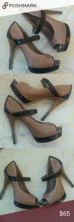 Jessica simpson heels Black and tan heels. Jessiza Simpson size 7 with front strap and snakeskin trim on front and heel as pictured. Beautiful shoes for going out. Some Marks and scuffs on shoe and heel as pictured from usual wear. Jessica Simpson Shoes Heels