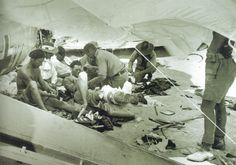 Crete 1941. Wounded Fallschirmjager being treated by New Zealand doctors. The wounded from the intense fighting in the Malemes (Western Sector) being treated under the shelter of a parachute, note the JU88 that has crashed and being used as part of the shelter.... Pin by Paolo Marzioli