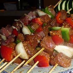 Awesome Spicy Beef Kabobs OR Haitian Voodoo Sticks Recipe - This fiery dinner goes great with fresh pitas, chopped onion, and sour cream to temper the black magic heat! Trust me, youll crave them!
