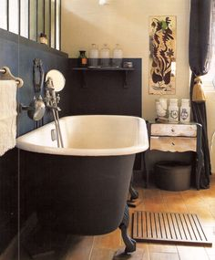 Interior Envy: 22 Clawfoot Tubs We Love - - Looking for a spa-worthy soak? We may just have the clawfoot tub of your dreams… or 22 of them ; Home, Bathroom Inspiration, Brown Floors, Black Tub, Modern Room, Beautiful Bathrooms, Black Clawfoot Tub, Clawfoot Tub, Bathroom Design